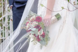 Special Moments Event Planning - Tammy Waterman - Clearwater Beach Wedding Planner - best wedding planner in Tampa Bay - white and red bridal bouquet