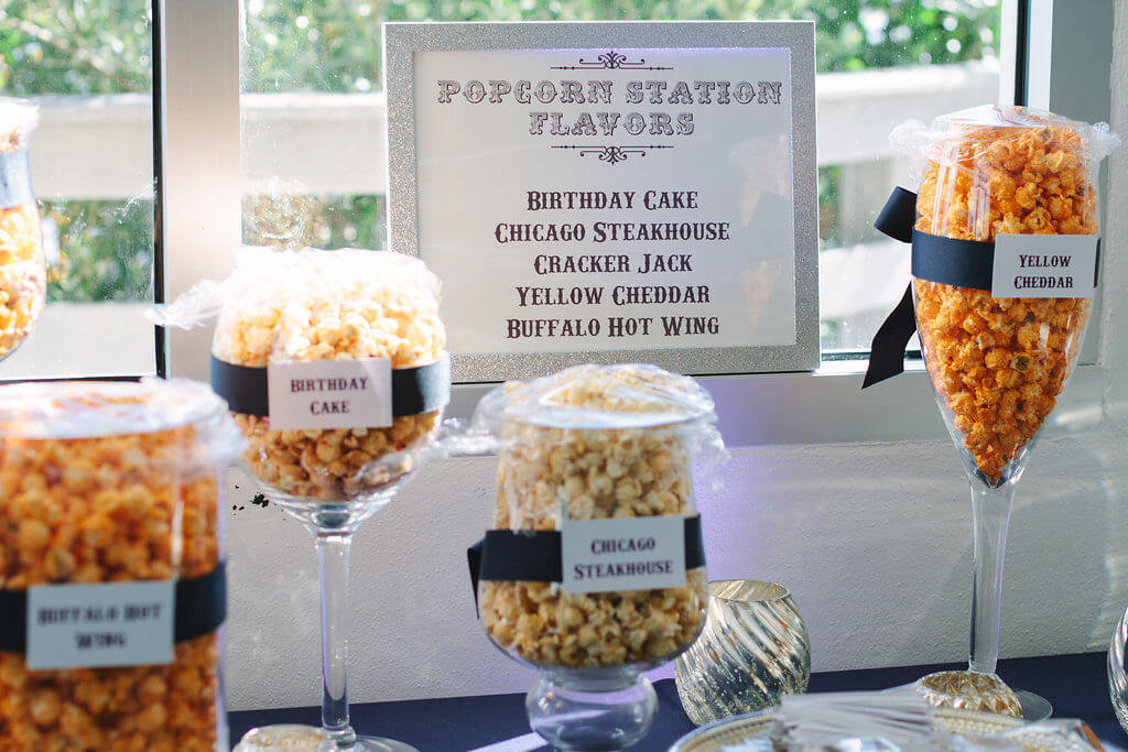 fun flavored popcorn in individual bags or as a buffet make for a great edible wedding favor