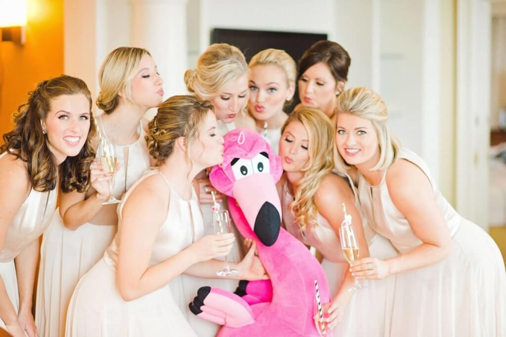 bride- bridesmaids- bride with pink flamingo