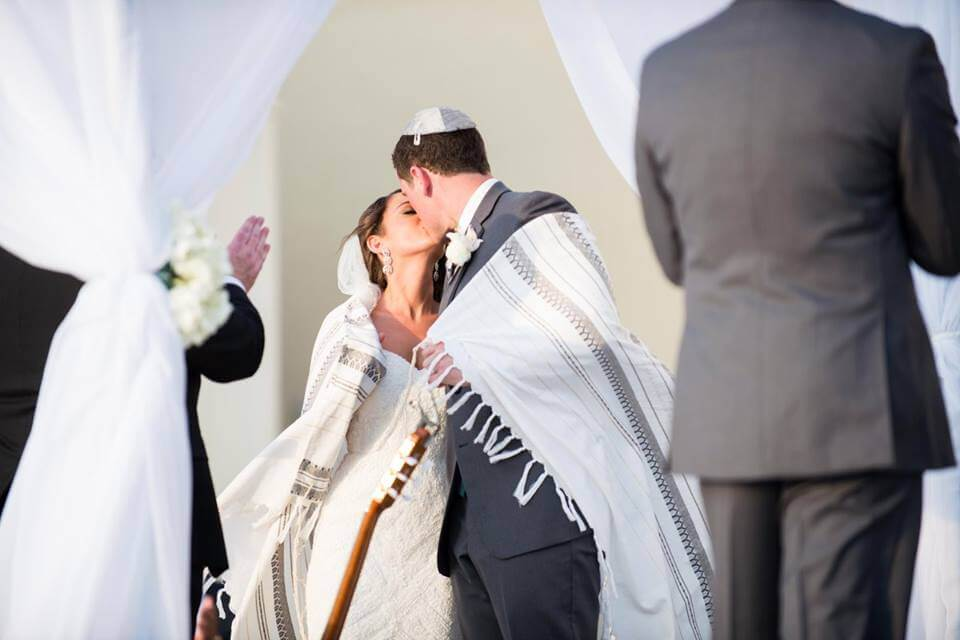 jewish wedding - Tampa jewish wedding - bride and groom wrapped in Tallis kissing