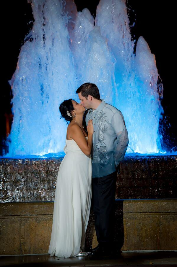 bride and groom - first kiss- bride and groom in front of fountain