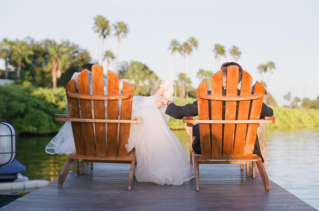 Events by Special Moments- Tampa wedding planner – Grand Hyatt Tampa Bay – Tampa luxury weddings – Special Moments Event Planning -bride and groom sitting on dock