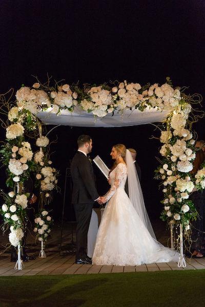 Clearwater beach weddings – clearwater beach Jewish wedding – Sandpearl Resort weddings - chuppah - bride and groom - exchanging wedding vows