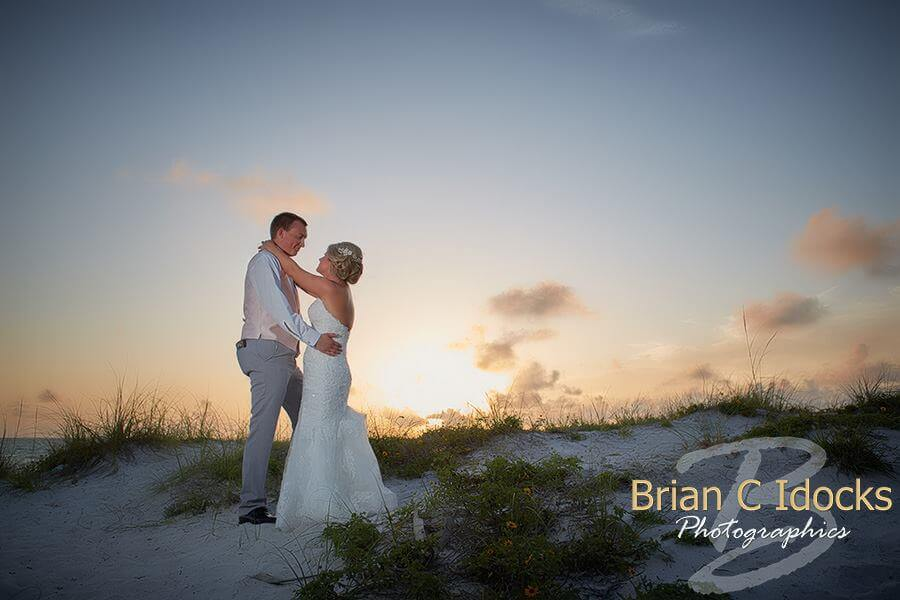 sunset on clearwater beach - clearwater beach sunset wedding - bride and groom at sunset- clearwater beach destination wedding at sunset