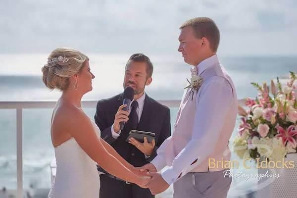 bride and groom exchanging vows - clearwater beach destination wedding - gulf of Mexico - clearwater beach