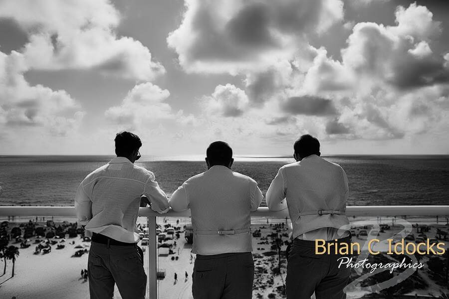 groom overlooking gulf of Mexico- clearwater beach - groom and groomsmen at sunset