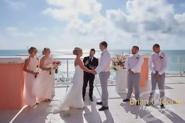 bride and groom - exchanging wedding vows- clearwater beach wedding- clearwater beach destination wedding -