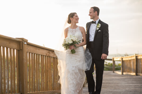 Bride and groom on boardwalk - Clearwater Beach wedding - events by special moments