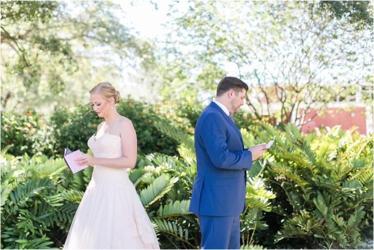 Special Moments Event Planning – Tampa Wedding Planner – Davis Island Garden Club – Davis Island Garden Club Wedding -bride and groom reading notes from the other