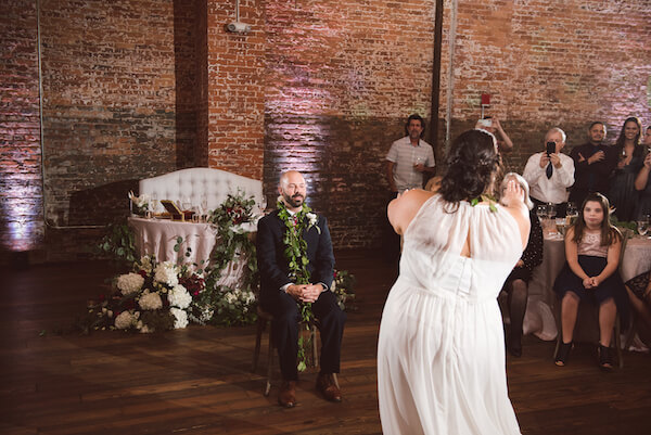 Special Moments Event Planning – Tampa Wedding Planner – Tampa Bay Wedding Planner- Tampa Wedding – Armature Works wedding - bride dancing hula for groom