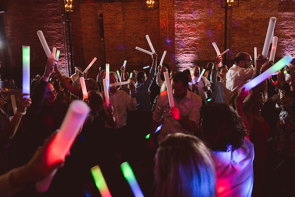 Special Moments Event Planning – Tampa Wedding Planner – Tampa Bay Wedding Planner- Tampa Wedding – Armature Works wedding - dancing with glow sticks