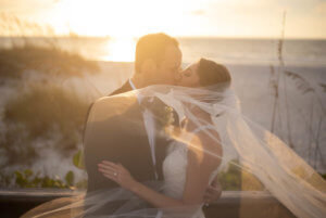 Special Moments Event Planning - bride and groom at sunset on Clearwater Beach - Carlouel Yacht and Country Club