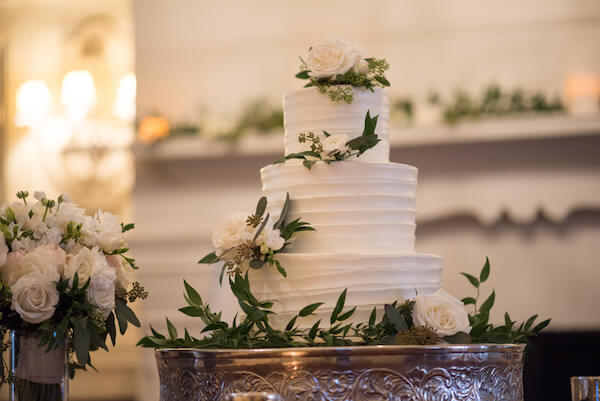 White wedding cake with white flowers- Clearwater Beach wedding - Special Moments Event Planning