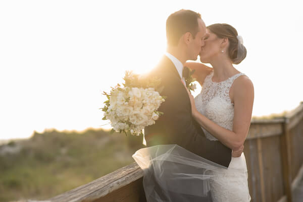 bride and groom kissing at sunset - Clearwater Beach wedding - events by special moments