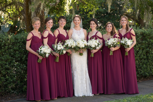bridesmaids in off the soulder burgundy bridesmaids dresses