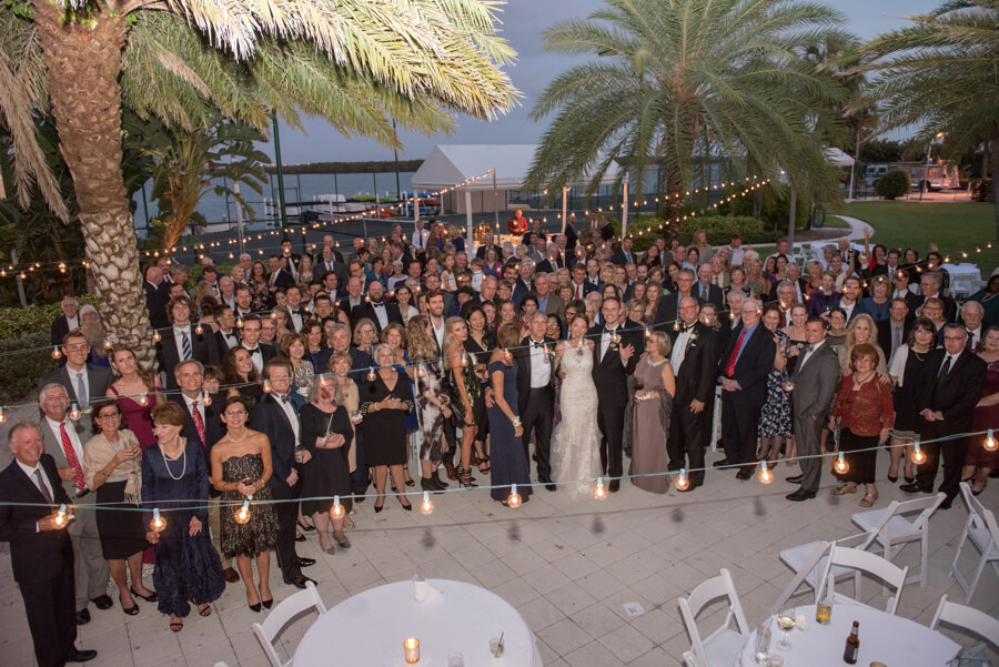 photo with all of the wedding guests - Carlouel Yacht and Country Club - Clearwater Beach wedding