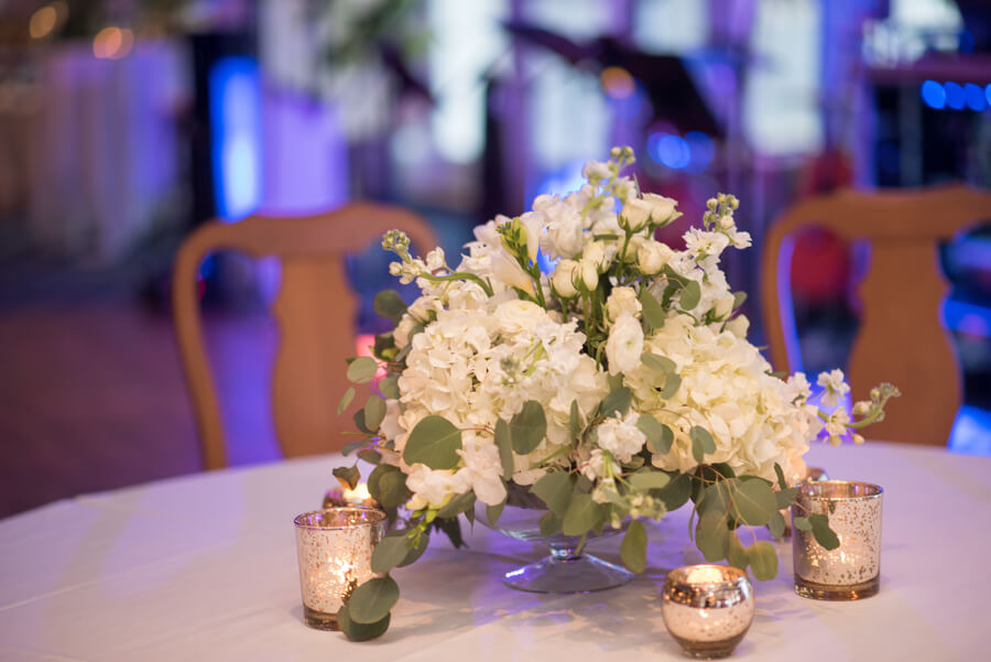 White centerpieces with mercury glass votive candles - Clearwater Beach Wedding - Special Moments Event Planning