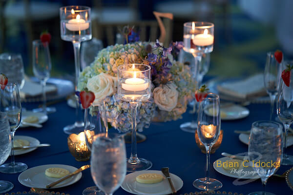 Opal Sands Wedding- Clearwater Beach Weddings – Clearwater Beach Wedding Planner - blue and gold wedding-wedding centerpieces with floating candles