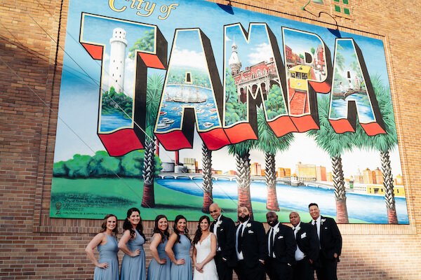 Tampa wedding – downtown Tampa wedding – Sacred Heart Tampa wedding – The Hip Room Wedding - Tampa Wedding planner - wedding party in front of tampa mural