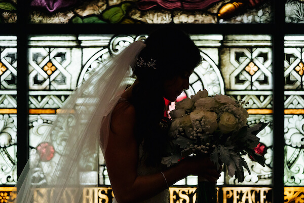 Tampa wedding – downtown Tampa wedding – Sacred Heart Tampa wedding – The Hip Room Wedding - Tampa Wedding planner - bride in front of stained glass window