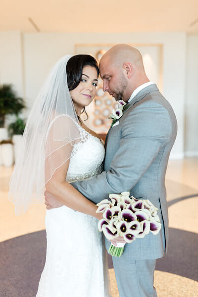 Opal Sands Wedding – Clearwater Beach Wedding – purple and white wedding-bride and groom