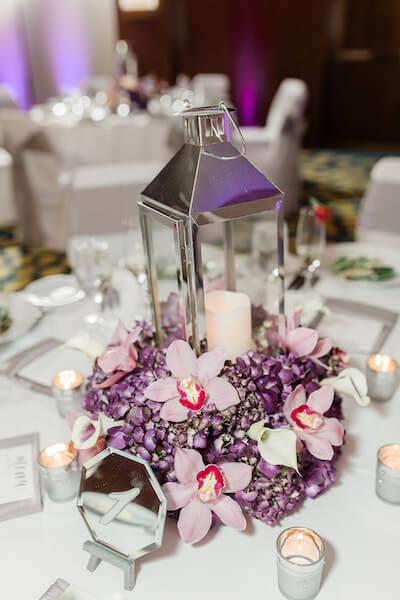Opal Sands Wedding – Clearwater Beach Wedding – purple and white wedding- chrome lantern wedding centerpiece