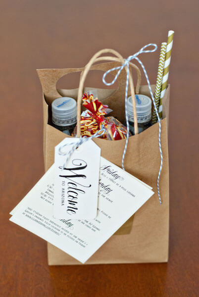 Welcome bags for wedding with water, paper straws and local snacks