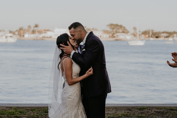 Clearwater Beach Wedding – Clearwater Beach Recreation Center wedding- Clearwater Beach wedding planner - first kiss