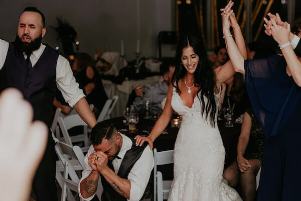 Clearwater Beach Wedding – Clearwater Beach Recreation Center wedding- Clearwater Beach wedding planner -groom falling to his knees in praise