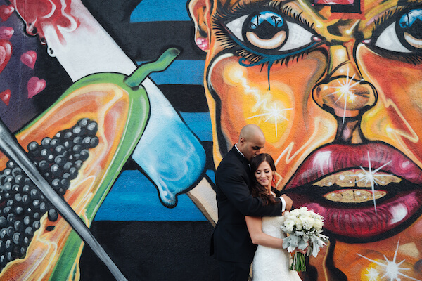 Tampa weddings – Tampa wedding planner – iconic Tampa wedding photos – Special Moments Event Planning - Tampa Murals - bride and groom in front of Tampa mural