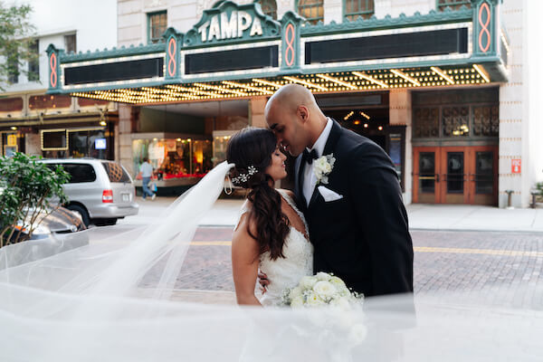 Tampa weddings – Tampa wedding planner – iconic Tampa wedding photos – Special Moments Event Planning - bride and groom at Tampa Theater - Tampa Theater