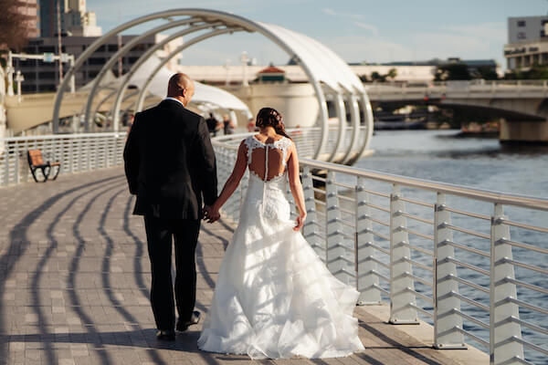Tampa weddings – Tampa wedding planner – iconic Tampa wedding photos – Special Moments Event Planning - bride and groom walking in downtown Tampa