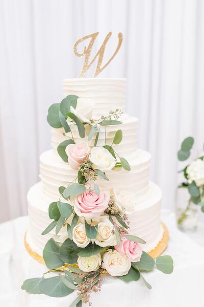 Innisbrook Resort wedding – Palm Harbor wedding – white wedding cake with roes - monogrammed cake topper