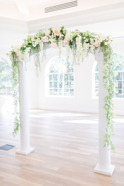 Harborside Chapel – Harborside Chapel wedding ceremony – Palm Harbor wedding – white wedding arch with pink and white flowers