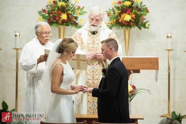 The Vault – Tampa Wedding Venue – Tampa Wedding Planner - exchanging wedding rings