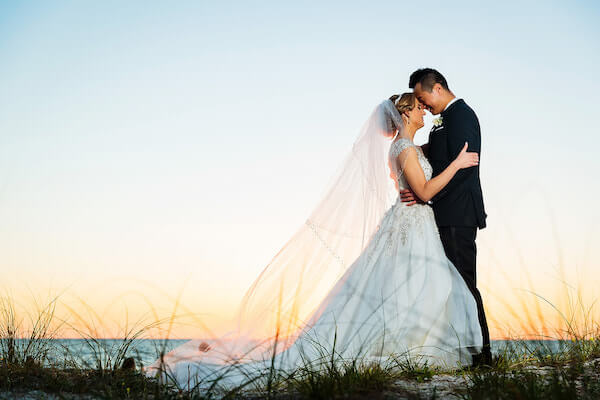 Clearwater Beach Wedding – Hyatt Regency Clearwater Beach – Clearwater Beach wedding planner - bride and groom at sunset