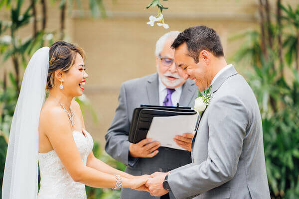 Tampa wedding planner- Special Moments Event Planning – Tampa Garden Club wedding - bride and groom exchanging vows - garden wedding ceremony