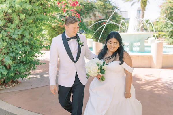 bride and groom - groom in white tuxedo jacket - just married - St Petersburg wedding - St Petersburg wedding planner