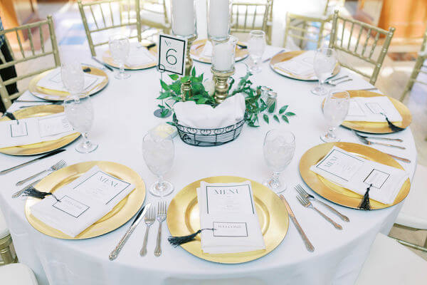 St Petersburg wedding planner - St Petersburg wedding reception - Poynter Institute for Media Studies - gold charger plates - black and white wedding decor - black and white menu cards