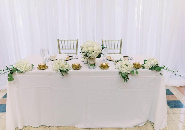 white draping - sweetheart table - St Petersburg wedding reception - St Petersburg wedding planner - Poynter Institute for Media Studies