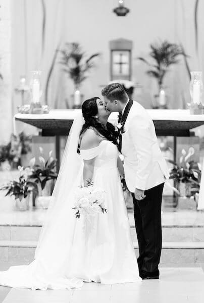 bride and groom - Catholic wedding ceremony - St Petersburg wedding - St Petersburg wedding planner - first kiss- just married