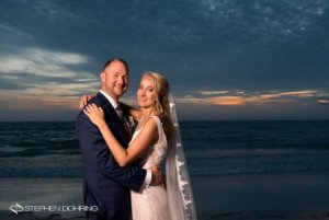 Special Moments Event Planning – Clearwater Beach wedding planner- Sandpearl wedding – Clearwater Beach wedding - bride and groom on beach at sunset