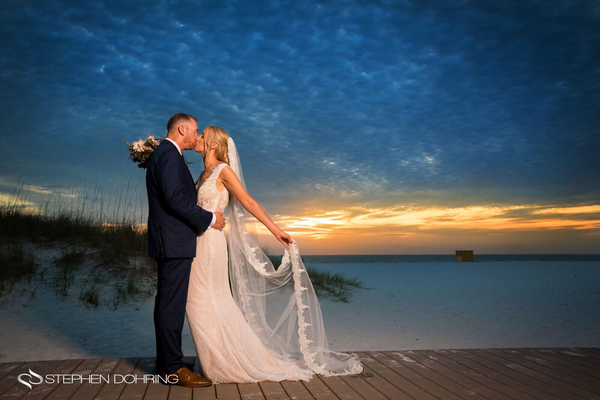 Special Moments Event Planning – Clearwater Beach wedding planner- Sandpearl wedding – Clearwater Beach wedding - bride and groom on the beach as sunset