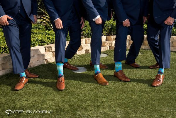 Special Moments Event Planning – Clearwater Beach wedding planner- Sandpearl wedding – Clearwater Beach wedding - groom wearing Bech themed socks with pink flamingos