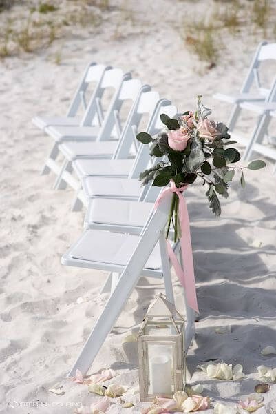 Special Moments Event Planning – Clearwater Beach wedding planner- Sandpearl wedding – Clearwater Beach wedding - white garden chairs - white garden chairs with pink flowers-