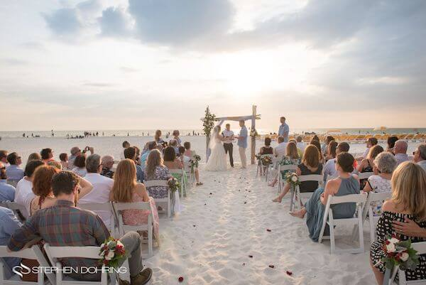 Special Moments Event Planning - Sandpearl Resort - Clearwater Beach Wedding - exchanging wedding vows - bride and groom - sunset wedding on the beach