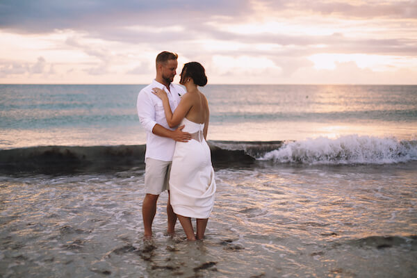 Special Moments Event Planning – Clearwater Beach Wedding – Clearwater Beach Wedding Planner- Clearwater Beach Destination Wedding- bride- groom - bride and groom at sunset - bride and groom at sunset on Clearwater Beach - brie era groom in the Gulf of Mexico