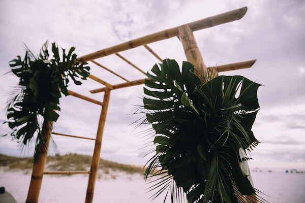Special Moments Event Planning – Clearwater Beach Wedding – Clearwater Beach Wedding Planner- Clearwater Beach Destination Wedding- beach wedding ceremony - bamboo wedding arch - tropical wedding arch - wedding arch with palms - wedding arch with monstera leaves