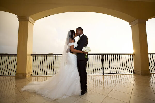 Bride and Groom overlooking beach - Clearwater Beach wedding - Tropical Storm Nestor - wedding planner rescues wedding