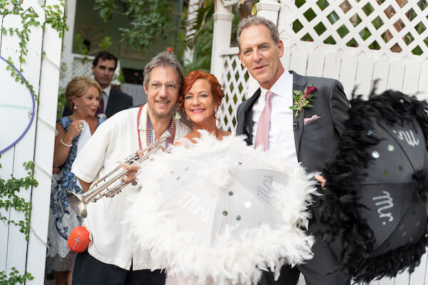 Special Moments Event Planning - second line - wedding parasol - st Petersburg wedding - st Petersburg wedding planner - unique wedding details - New Orleans jazz - buck jumping - trumpet - first line - bride and groom